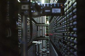 800px-Interior_of_StorageTek_tape_library_at_NERSC_ derrick coetzee wikimedia.jpg