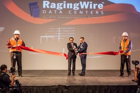 George Macricostas, CEO of Raging Wire (right), and Akira Arima, president and CEO of NTT Communications (left), officially open CA3