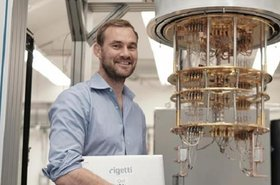 Chad Rigetti near one of his quantum computers .jpg