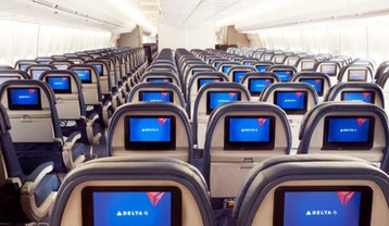In-flight entertainment screens on a Delta aircraft