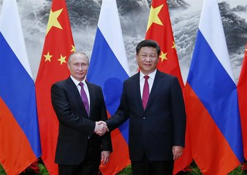 Russia's Putin and China's Xi Jinping shake hands