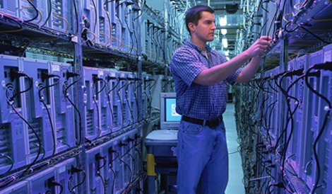 A Rackspace tech in a data center aisle