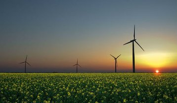 Wind, sun and biomass renewable energies. Courtesy of Creative Commons.