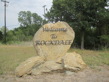 Sign welcoming visitors to Rockdale, TX