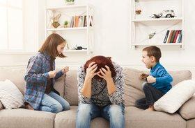 Kids squabbling, despairing mum