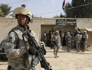 US Army private first class Chris Craighead at an election site in Iraq in 2009. Image courtesy of the US Army.