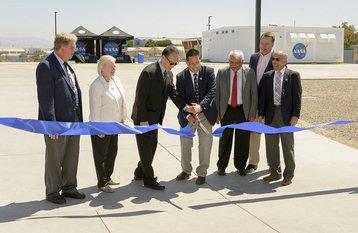 Tsengdar Lee, NASA High-End Computing program manager, and Eugene Tu, NASA Ames Research Center director, cut the ribbon at the opening of NASA's Modular Computing Facility