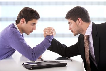 boardroom fight arm wrestle tech v business thinkstock photos welczenbach tams