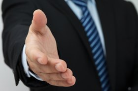 businessman handshake welcome hire employ deal hand thinkstock daizuoxin