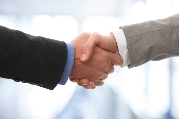 handshake merger acquisition deal thinkstock eszter szepessy