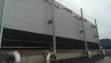 A typical larger evaporative cooling tower which will benefit from thermal testing to ensure optimum performance.