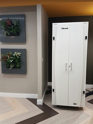 A micro data center can sit in an acoustic cabinet, in the corner of your office