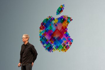Tim Cook and the Apple logo