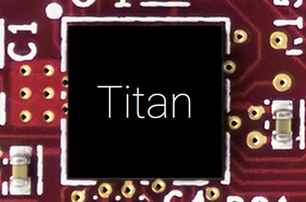 """Photograph of Titan up-close on a printed circuit board. Chip markings obscured"""