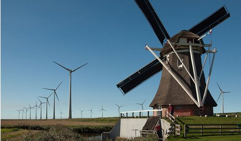Old versus new: a wind farm in Eemshaven
